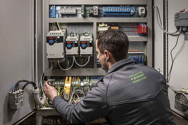 https://www.ampcleanenergy.com/wp-content/uploads/AMP-open-cabinet-with-engineer.jpg