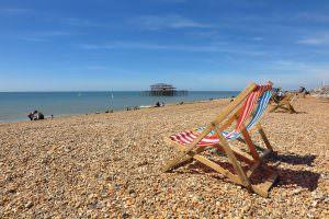 Beach chairs on a pebbled beach