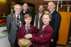 Croft School pupils holding Wood Pellets