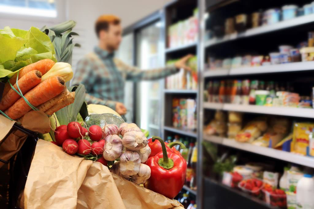 man grocery shopping at a supermarket