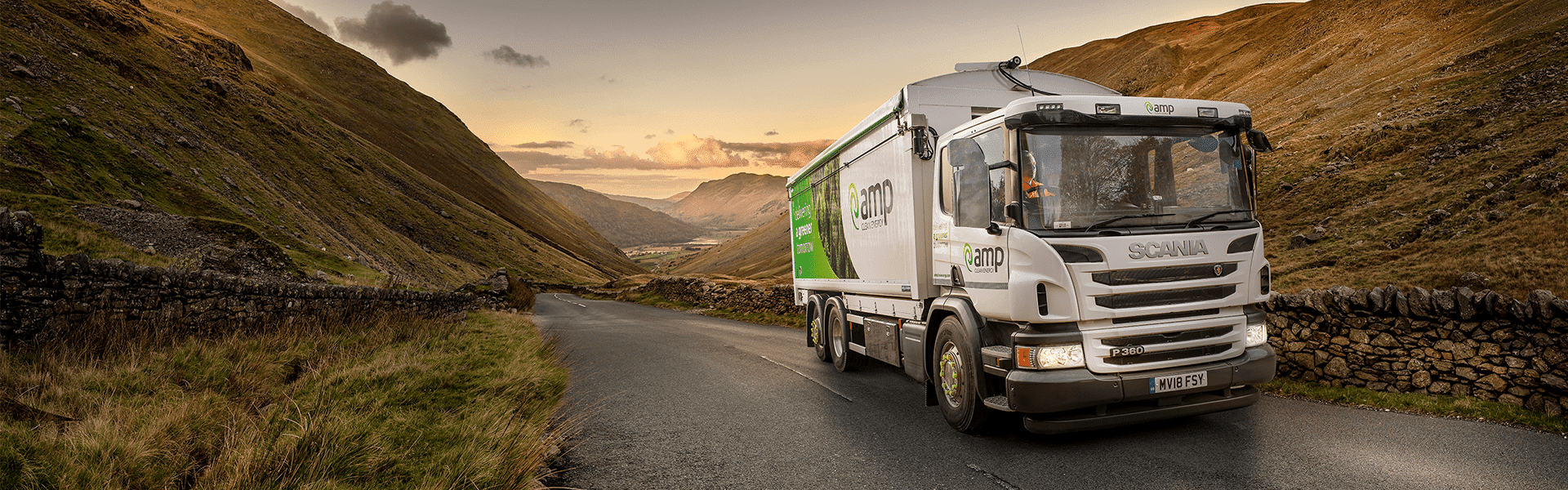 AMP truck driving through the lake district